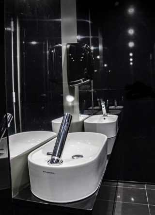 double anteroom sink with mirrors and soap dispenser